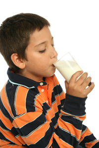 Teenager enjoying a fresh glass of milk