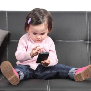 Cute baby browsing in a smartphone