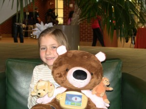 "Ashlynn with ""Jerry"" the diabetic bear helping children with diabetes"