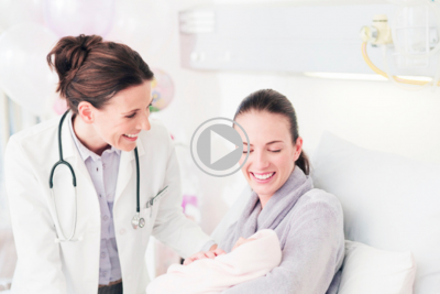 new mom and doctor admiring newborn baby